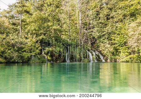 landscape with waterfall of plitvicka lake national park at sunset unesco heritage site plitvice croatia.