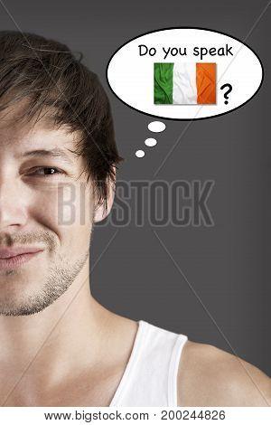 Handsome student thinking do you speak Irish?