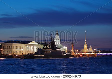 ST. PETERSBURG, RUSSIA - JULY 21, 2017: Corvette Stoykiy anchored in Neva river against famous city landmarks. The warships entered Neva to participate in naval parade dedicated to the Navy Day
