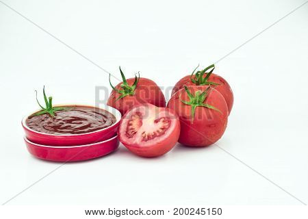 Sliced Tomatoes and Sauce in White Background