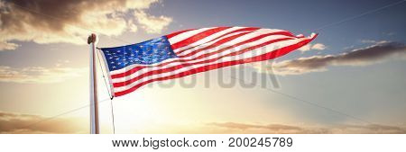 American flag waving over white background against panoramic view of golden fields