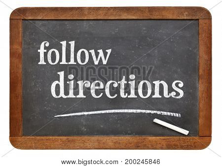 Follow directions sign - white chalk text on a vintage slate blackboard