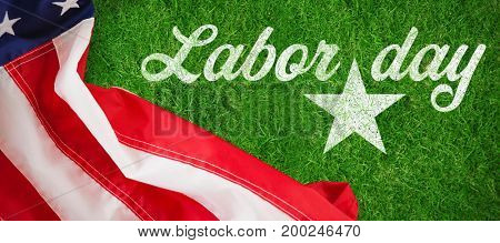 Digital composite image of happy labor day text with star shape against closed up view of grass