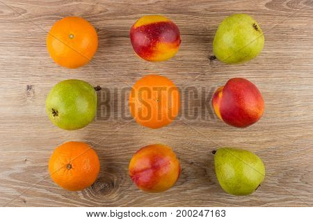Rows Of Different Fruits On Wooden Table