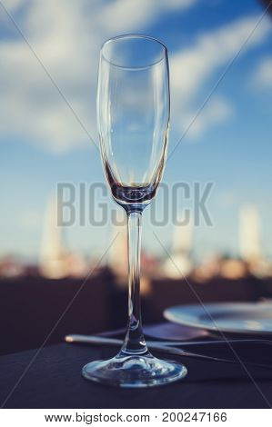 Empty glass wineglass on the sky background