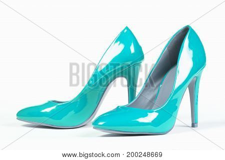 Lacquered shiny blue shoes high heels on white background.