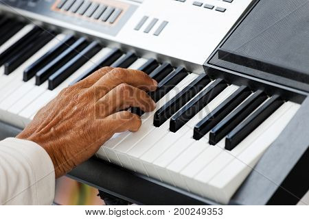 Closeup hand of musician pianist playing a piano. Shallow focus.