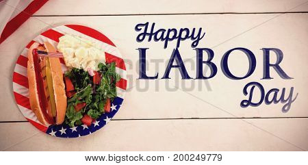 Poster of happy labor day text against hot dog with american flag in plate