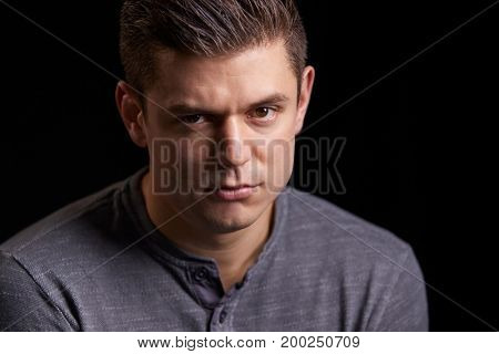 Portrait of a worried young white man looking to camera