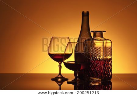 Glasses Of Brandy On The Reflective Background