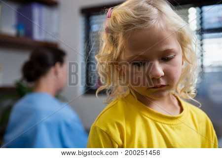 Close-up of sad girl in clinic