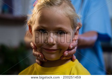 Female doctor examining a little girl in hospital