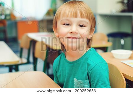 Portrait Of Cute Little Boy In Classroom, Indoors