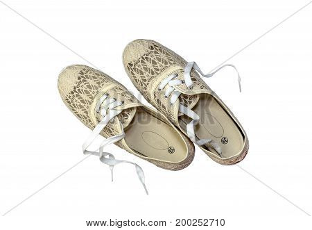 Women's sports, beige shoes on a white background closeup