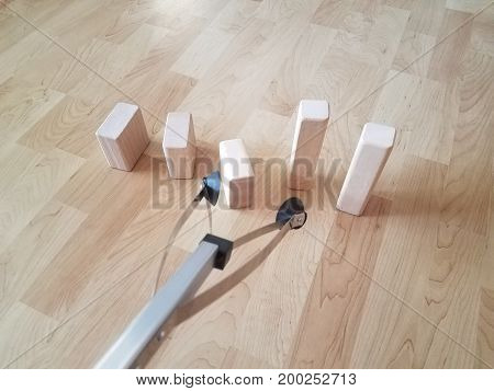 tool to grab objects with wooden blocks on woodfloor