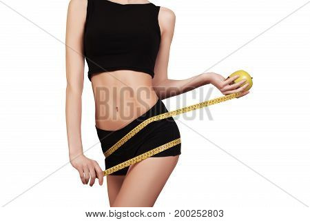 Slim Female Measuring Her Thin Waist With A Tape Measure Isolated On White.