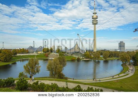 MUNICH GERMANY - OCTOBER 23 2016: The Olympia-Tower is located directly in the former Olympic Village and thus it is surrounded by extensive green areas and provides a multifaceted range of sports and leisure facilities.