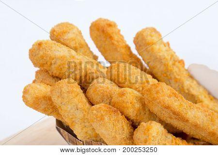 Deep fried chicken nugget stick on white background