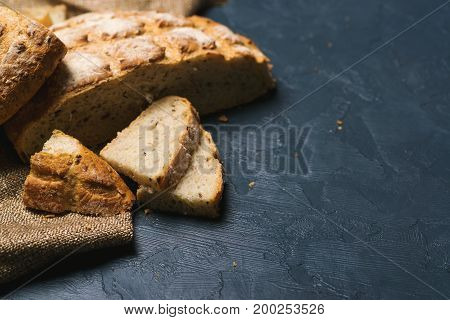Whole wheat bread baked at home bio ingredients very healthy with seeds. Copy space. Selective focus.