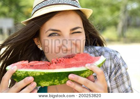 Happy young woman eating watermelon on the beach. Youth lifestyle. Happiness, joy, holiday, beach, summer happiness concept.