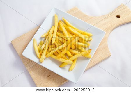 French fries original on a white plate with mayonnaise and cheese sauce