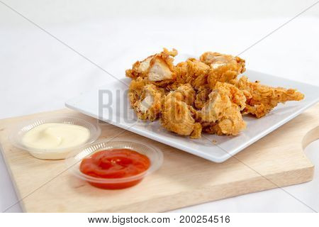Crispy crisp chicken fillet breaded with corn flake crumbs with sauce