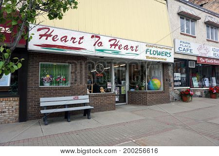 CADILLAC, MICHIGAN / UNITED STATES - MAY 31, 2017:  One may purchase gift baskets, flowers and balloons at Heart to Heart, on Mitchell Street in Downtown Cadillac.