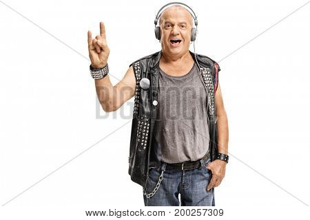 Elderly punker with headphones making a rock hand gesture isolated on white background