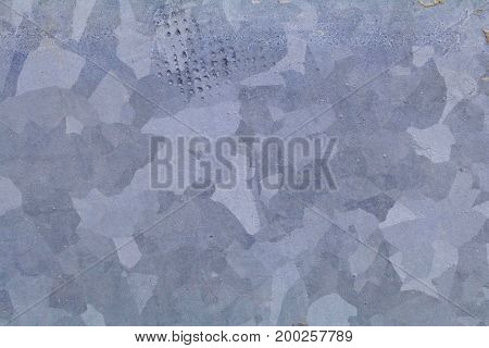 Galvanized metal closeup background showing the metal grain