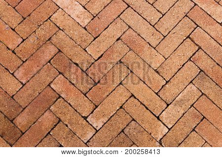A Herringbone pavers bricks from a path