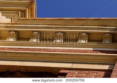Nineteenth century upper brick building facade detail