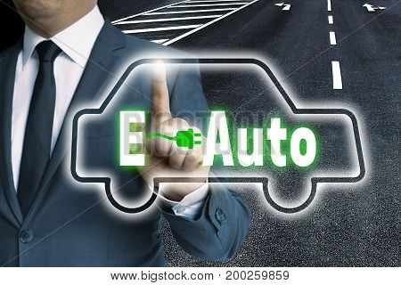 E-Auto touchscreen is operated by man picture