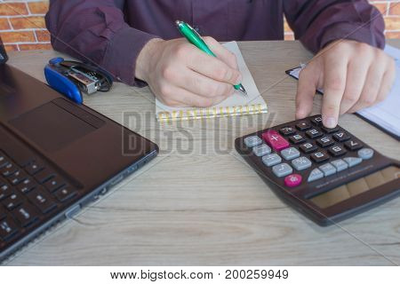 a business man working in home office table plan for business market analysis. Businessperson working in office