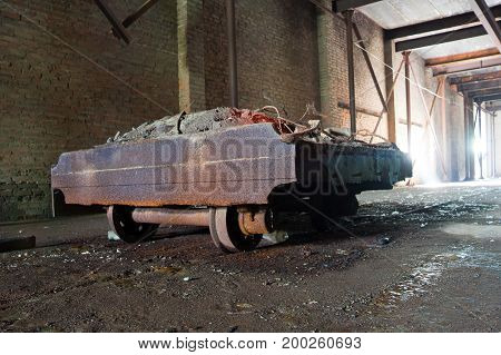 Old rusty trolley in abandoned brick factory in Voronezh