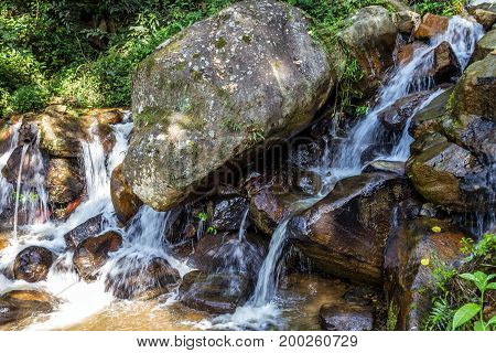 Beautiful Waterfall In The Jungle At Sunny Day