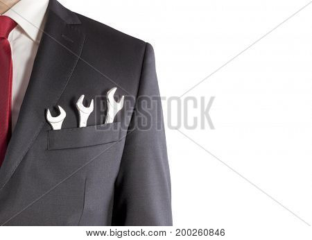 Businessman with three spanners in suit pocket isolated on white