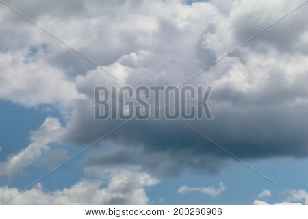 Blue grey altocumulus cloudscape with puffy clouds