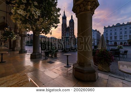 Pink sunrise in the main square of Krakow. Poland.