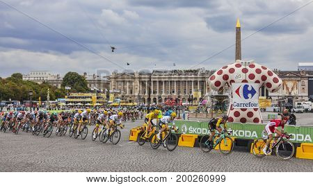 Paris France - 23 July 2017: The peloton including Chriss Froome in Yellow Jersey riding in Place de la Concorde in Paris during the last stage of Le Tour de France 2017.