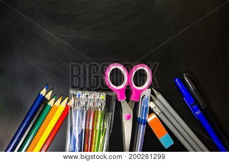 Set Of School Stationery Supplies On Blackboard. Back To School Concept