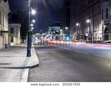 modern city street with lights and traffic at night. background citylife.