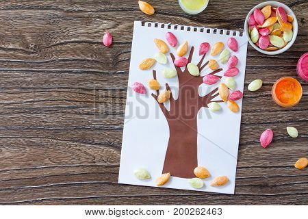 Autumn Tree With Colorful Different Leaves Pumpkin Seeds On A Wooden Background. Children's Art Proj
