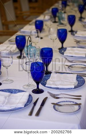Blue & white table setting for a large group.