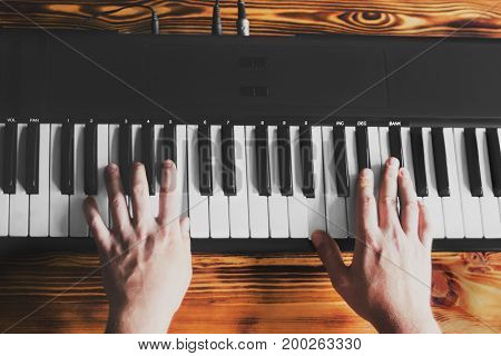 A man playing the synthesizer. Pianist creates music.