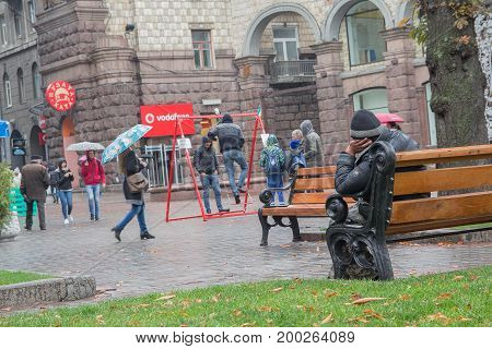 Kiev Ukraine - October 08 2016: Homeless sits on a bench in the city center
