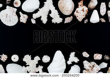 Frame made of sea shells on white background. Flat lay. Top view.