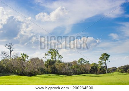 Pristine golf course under beautiful blue sky