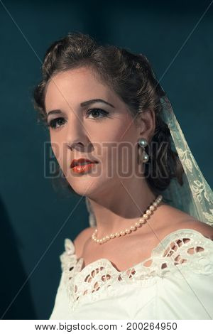 Vintage 1940S Bride In White Dress And Pearl Necklace. Studio Head Shot.