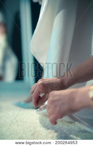 Hands Of Seamstress Doing Dress Of Retro 1940S Bride In Front Of Mirror.
