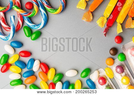Five Types Of Candies Over Grey Background